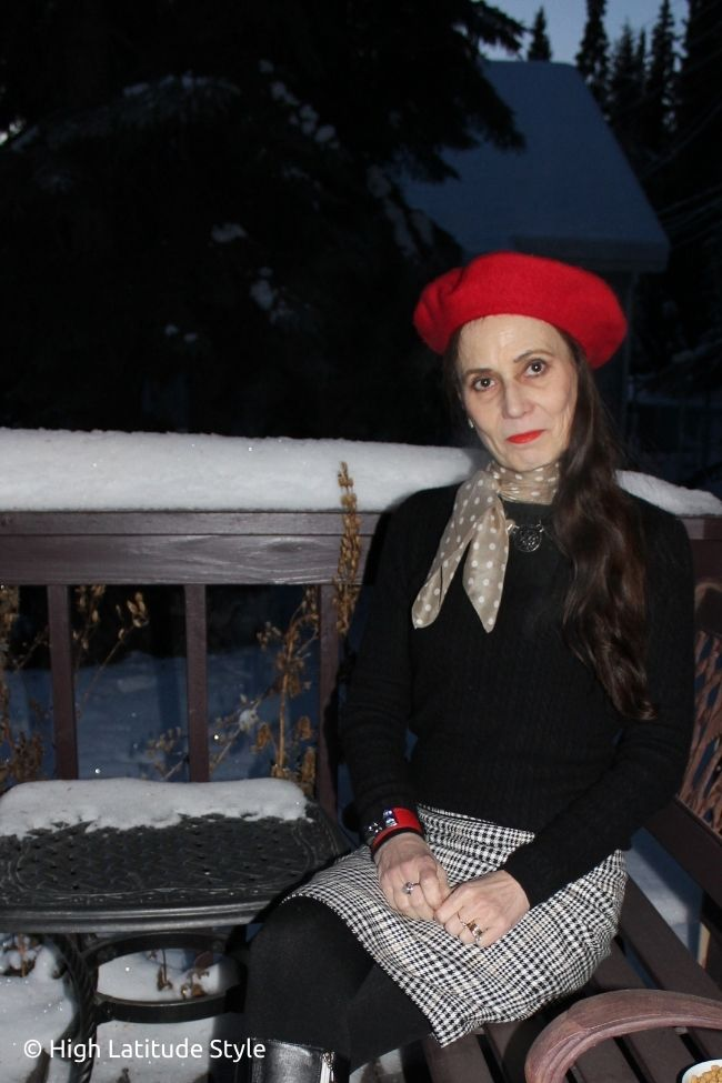 style book author in French chic look with sweater, tights, houndstooth straight skirt, polka dot scarf and cap