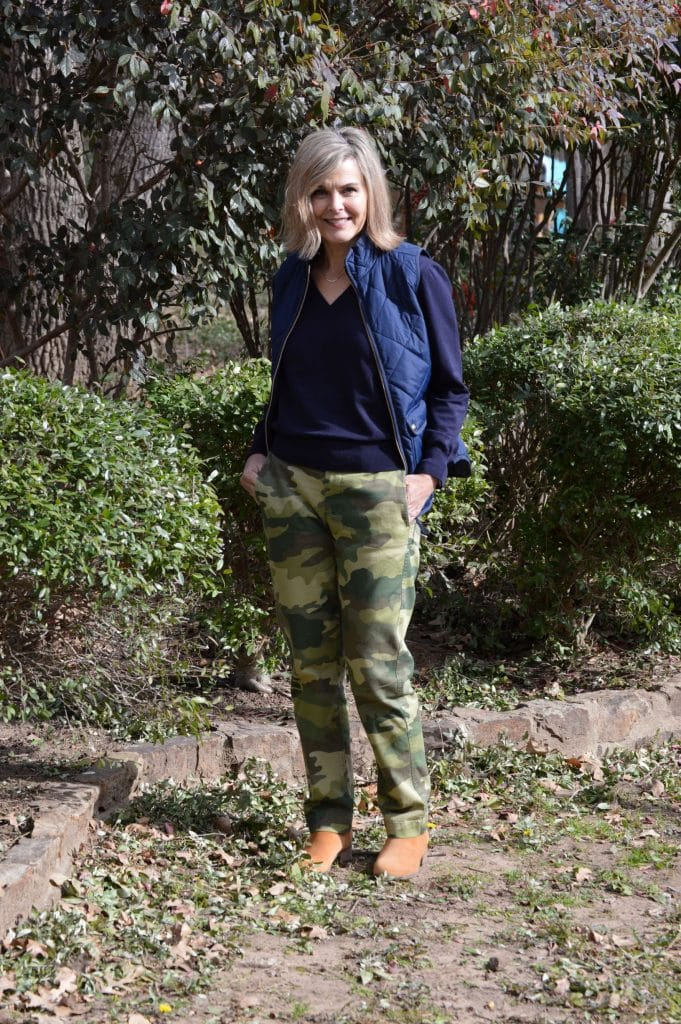 Carrie of A Stylish Fit in puffer bomber, T-shirt and camo pants