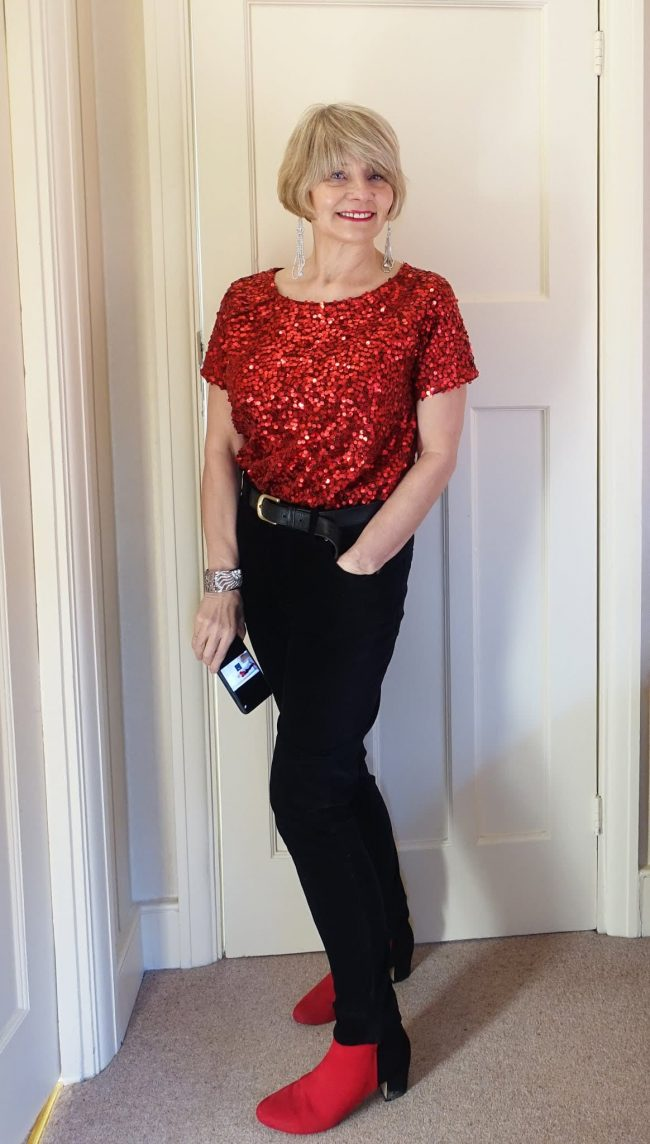 Gail in red sequin top and shoes with black dress pants