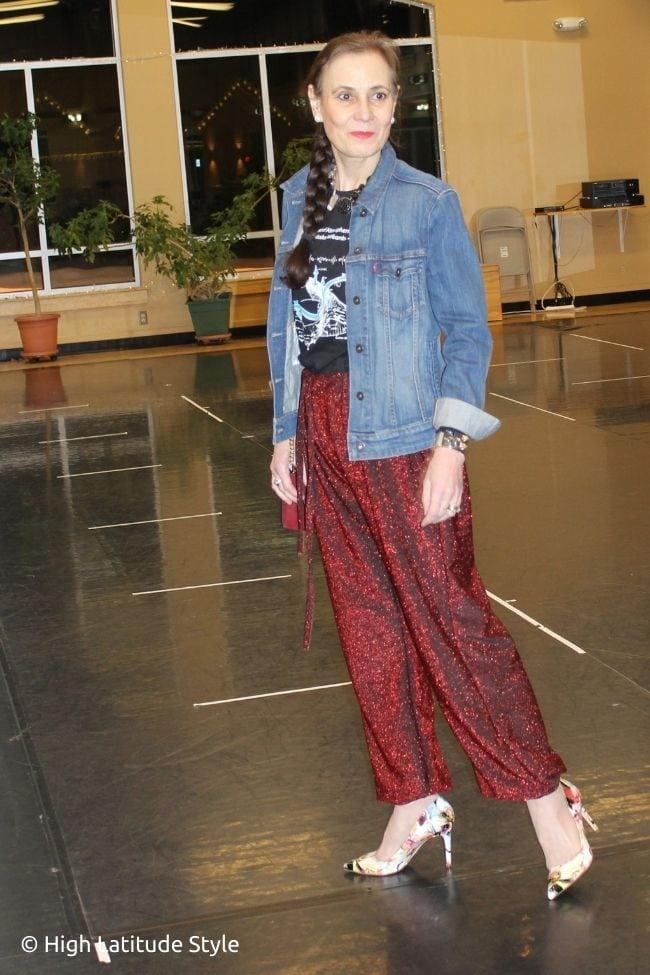 dancer in glitter burgundy jogging pants, college graphic Tee, oversize denim jacket