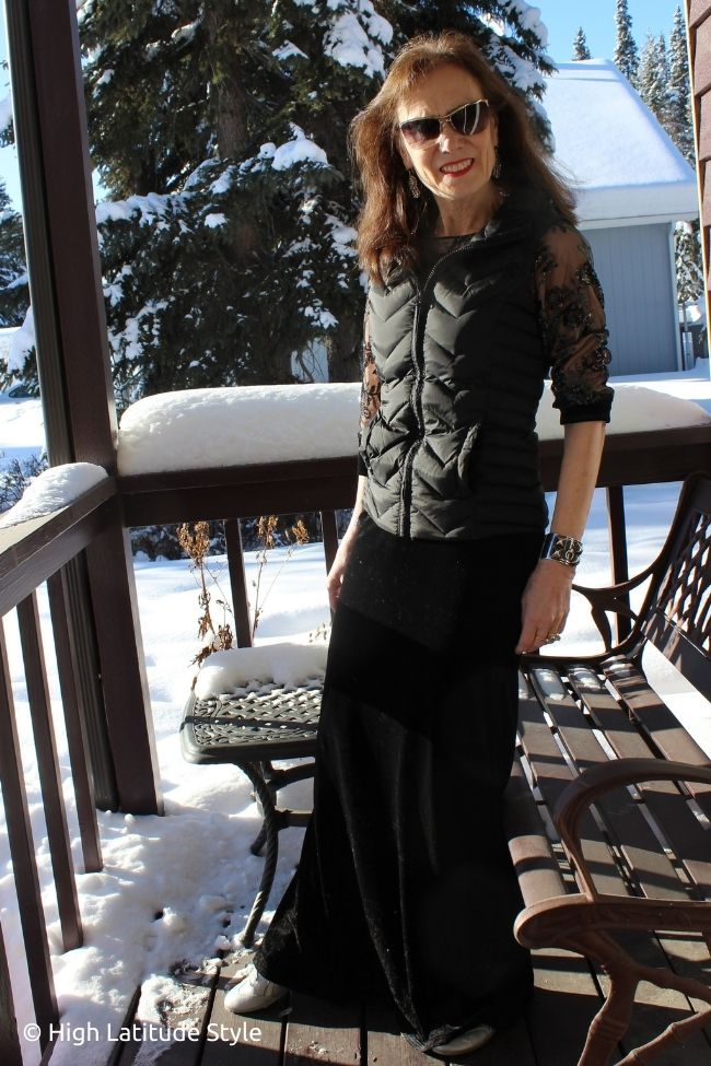 over 50 years old style blogger in maxi velvet dress with sequins and vest