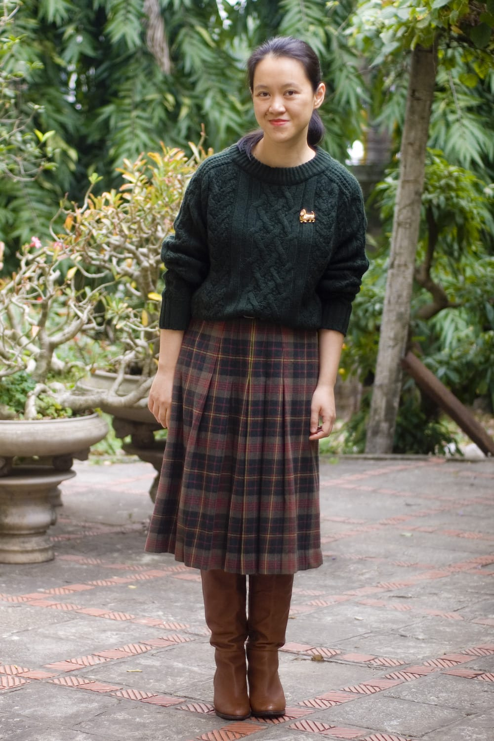 Salazar in preppy skirt sweater riding boots british style