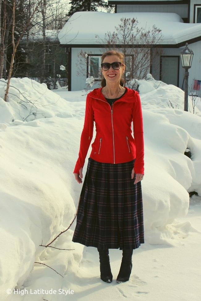 blogger wearing gymgear as a spring jacket with a long plaid skirt