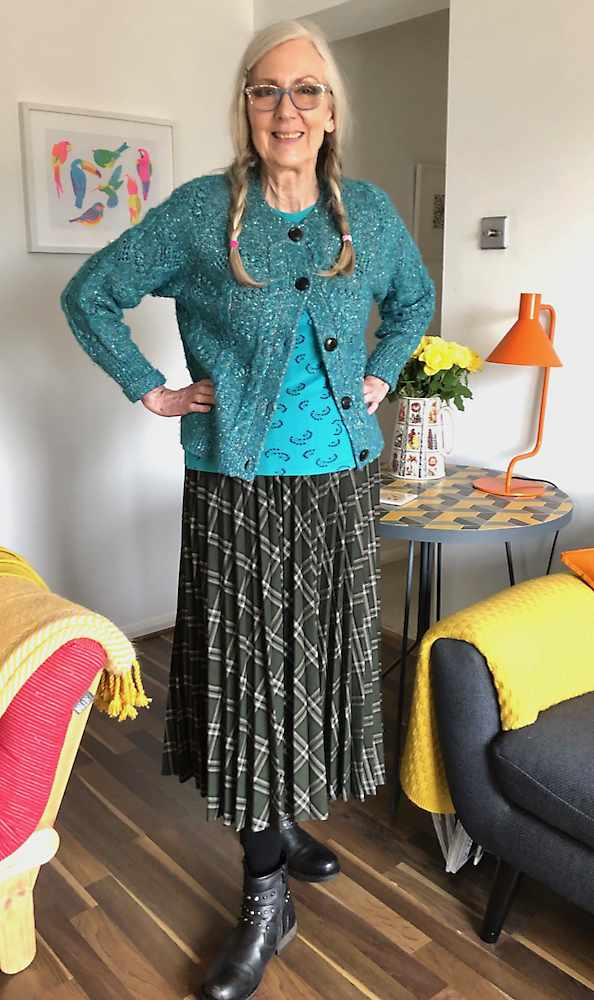 Penny Kocher in eclectic mix of skirt, knitsweater and top