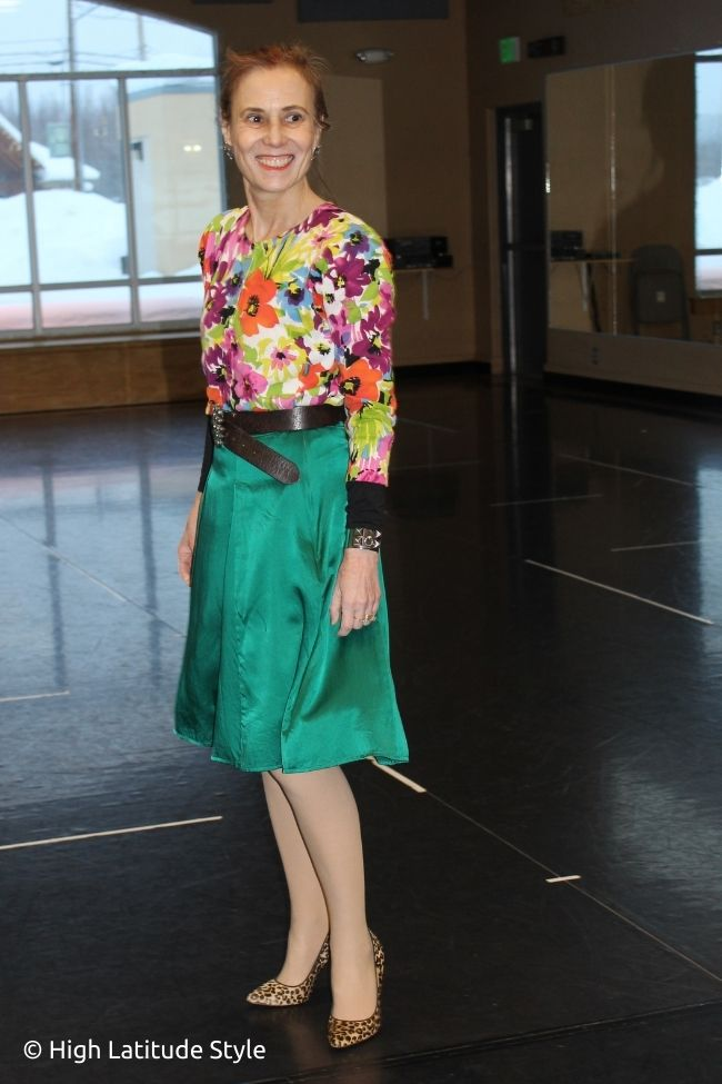 style book author in silk skirt floral top emerald belt buckle