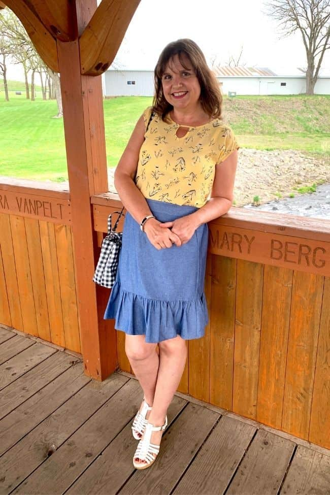 Amy in chambray skirt with decorative hem details