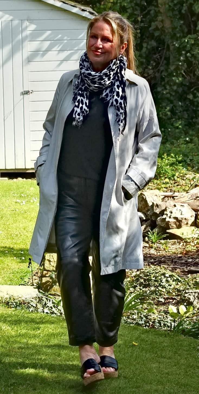 Alison in leather pants, black sweater gray denim coat, leopard print scarf