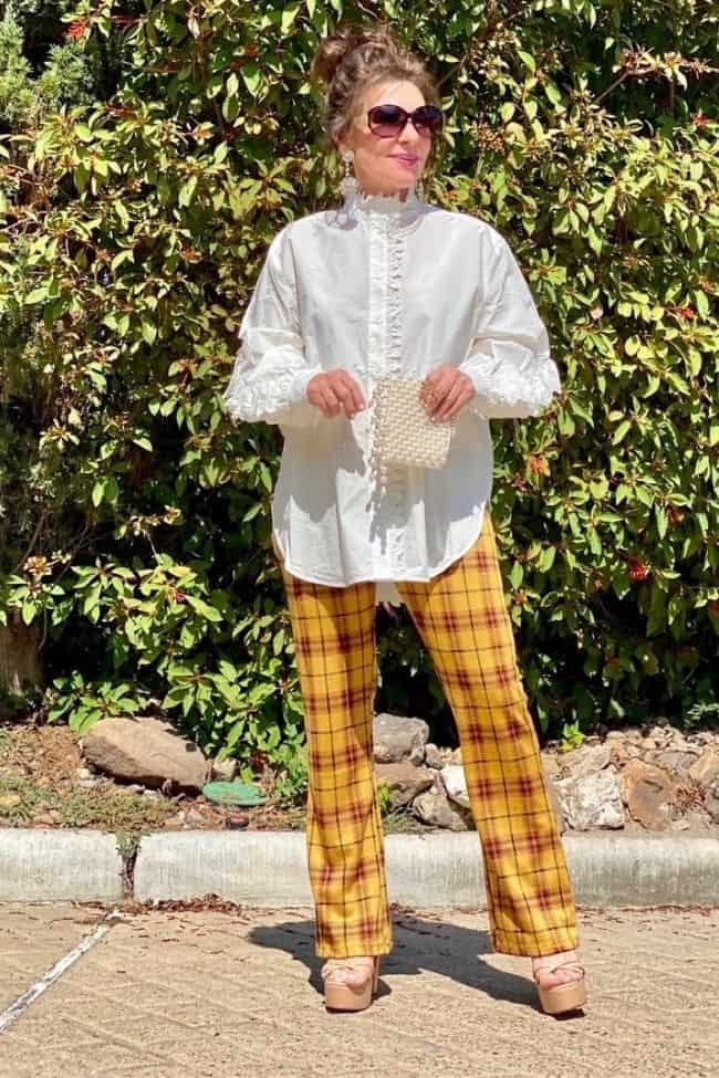 Suzanne in punky tartan pants and tuxedo shirt