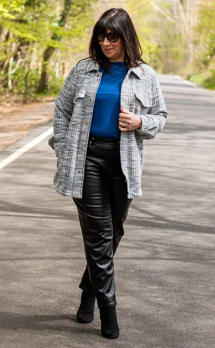 jacqui in gray long jacket blue sweater black leather pants and booties
