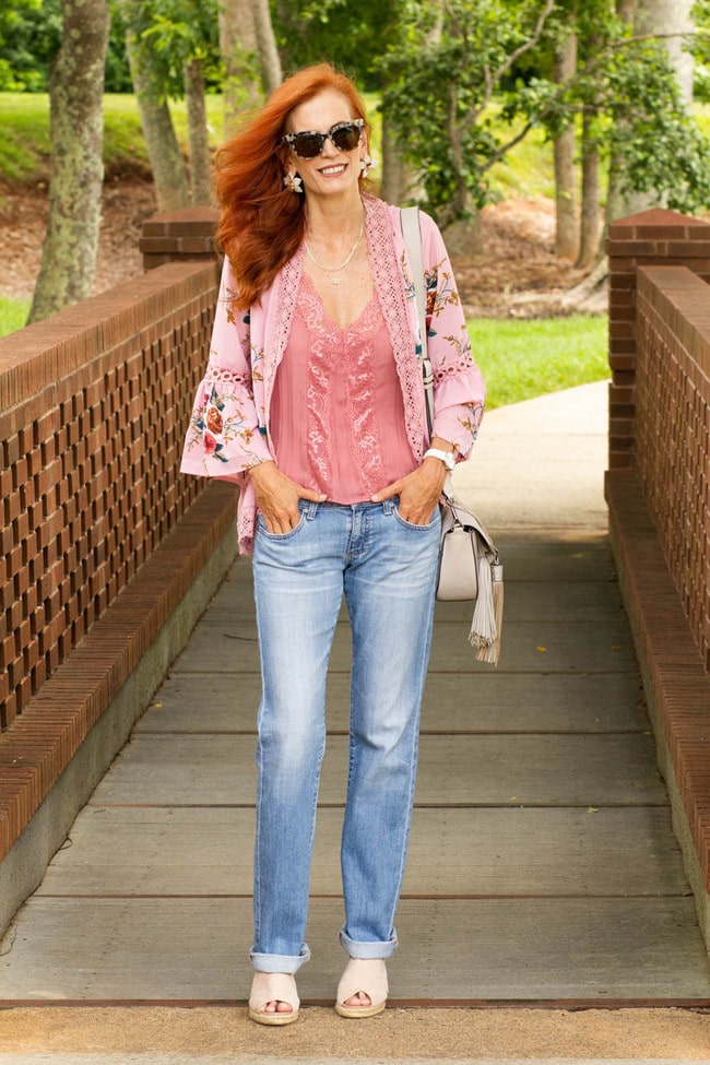 Jess in blue jeans,white floral print jacket pink top