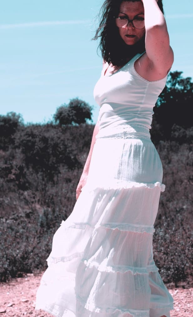 The Grey Brunette Suzy Turner in a white summer dress