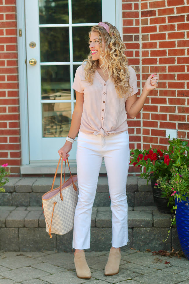 Laura Bramwick in white denim pants and blush henley