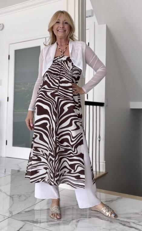 Lucy Bertoldi in zebra print dress over pants with bolero