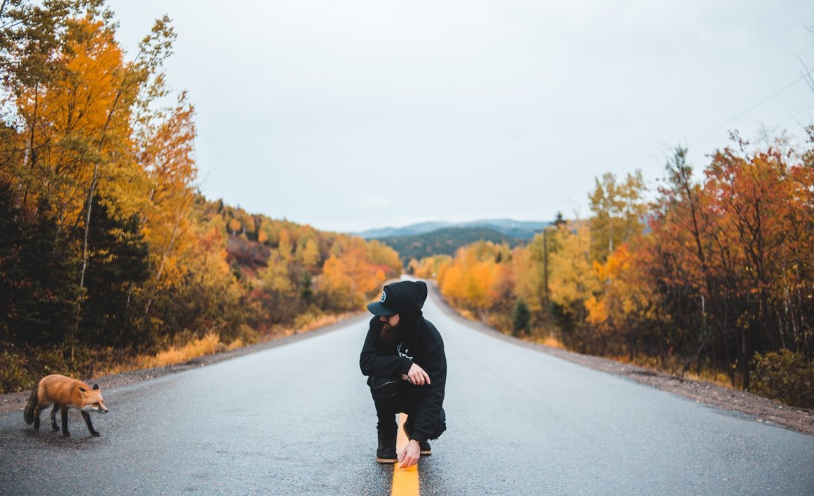 A highly sensitive person crouches in the road.