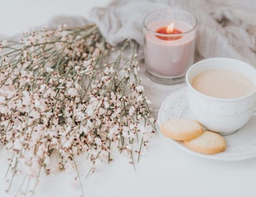 flowers and a candle representing hygge