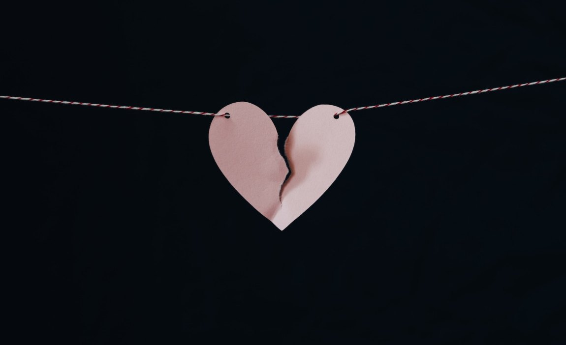 a broken paper heart represents an HSP's marriage ending