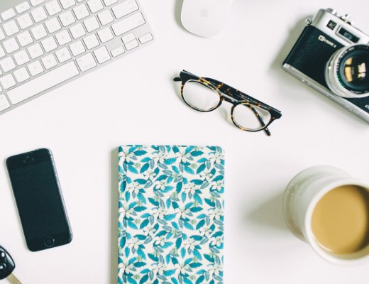 a notebook, coffee cup, and keyboard represent a highly sensitive person achieving their goals using the mind body heart system