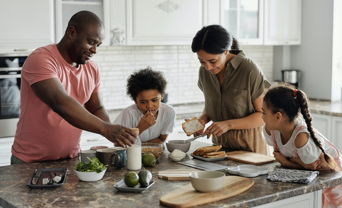 A highly sensitive mom makes food with her family