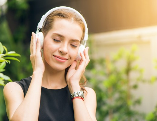 A highly sensitive person listens to an ASMR audio clip on headphones