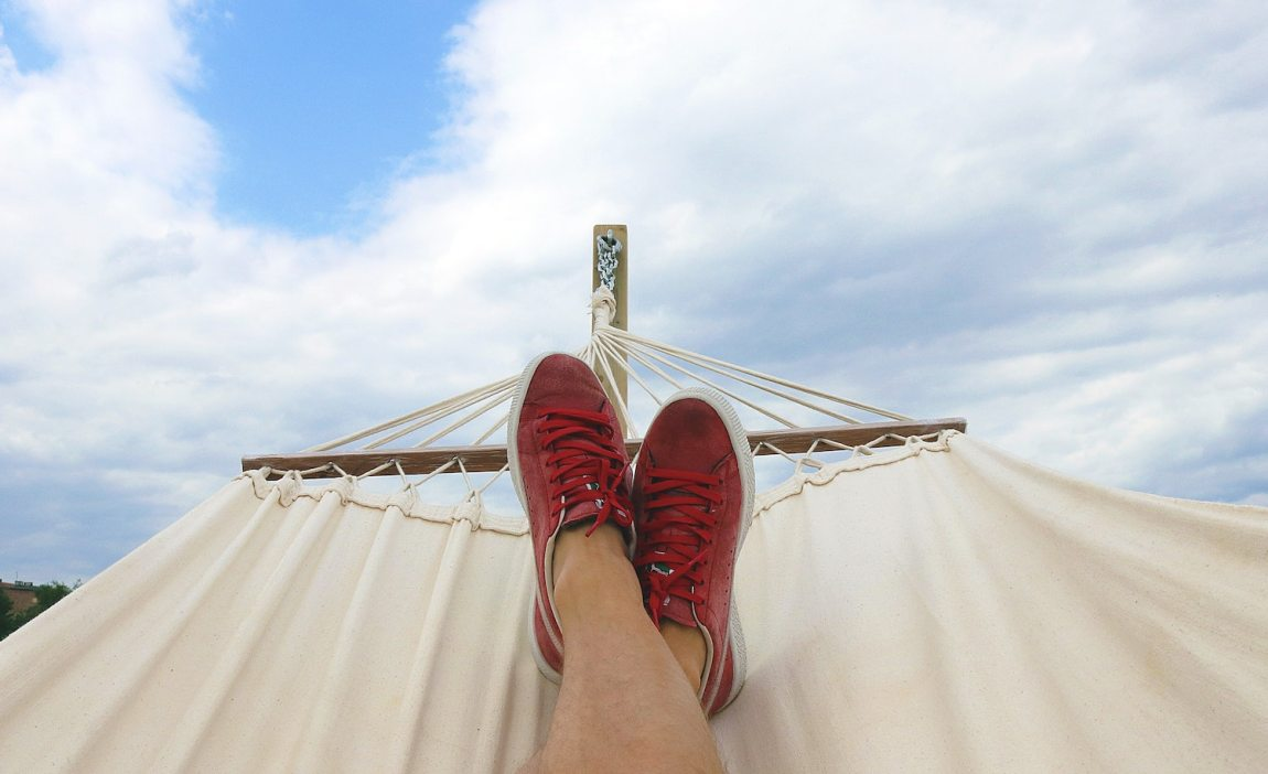 An HSP relaxing in a hammock to prevent overstimulation.