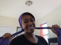 Long, rectangular, purple scarf separated into two twisted ends.
