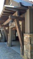 Custom wood beams highlight this living room - High Mountain Millwork Company, Franklin, NC