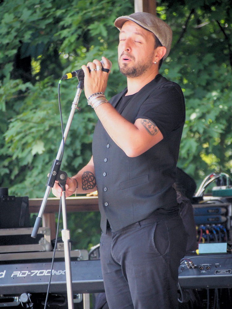 Andres Martorell of Baile An Salsa sings during the Celtic Workshop on the Camp Stage at the 56th annual Philadelphia Folk Festival (The High Note/ Shaun R. Smith).