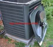 Unit with the top off - condenser fan motor being changed out and inspected