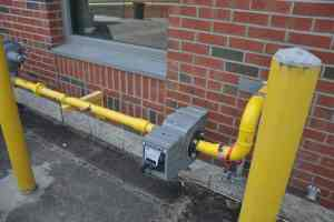 outdoor gas piping protected from vehivles