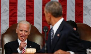 Vice President Joe Biden points at President Barack Obama during the State of the Union address to a joint session of Congress on Capitol Hill in Washington, Tuesday, Jan. 12, 2016. (AP Photo/Evan Vucci, Pool)