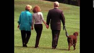 President Clinton, his daughter Chelsea, center, and wife Hillary walk with Buddy Tuesday, Aug. 18, 1998, from the White House toward a helicopter as they depart for vacation enroute to Martha's Vineyard, Mass. (AP Photo/Roberto Borea)