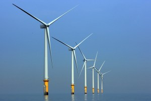 LIVERPOOL, UNITED KINGDOM - MAY 12:  Turbines of the new Burbo Bank off shore wind farm stand in a calm sea in the mouth of the River Mersey on May 12, 2008 in Liverpool, England. The Burbo Bank Offshore Wind Farm comprises 25 wind turbines and is situated on the Burbo Flats in Liverpool Bay at the entrance to the River Mersey, approximately 6.4km (4.0 miles) from the Sefton coastline and 7.2km (4.5 miles) from North Wirral. The wind farm is capable of generating up to 90MW (megawatts) of clean, environmentally sustainable electricity. This is enough power for approximately 80,000 homes. The site is run by Danish energy company Dong Energy.  (Photo by Christopher Furlong/Getty Images)