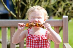 High Plains Beef image of little girl eating kabob