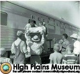 High Plains Museum | PM280RR Hospital and ambulance crew loading a patient on the Rock Island Railroad for transport to a larger hospital, 1955