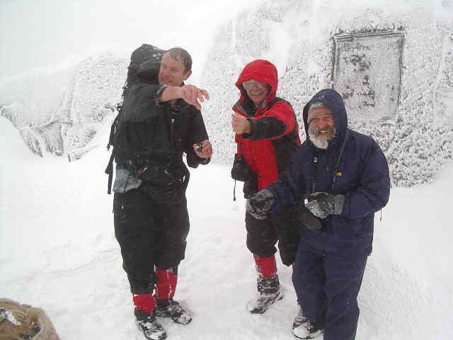Roger Rowlett, Stony Burke and Mario Locatelli sprinkle Jack Longacre's ashes on the Mount Marcy summit. Keep Klimbin!