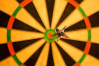 Dartboard with a dart in the bullseye