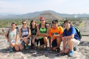 Students pose at the top of the Pyramid of the Moon at Teotihuacan.