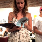 "Girl reading ""Steve Buscemi: God of Cinema"" zine"