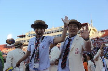Two athletes from Team Korea display their joy with a quick wave during the Special Olympics World Games Opening Ceremony on Saturday.