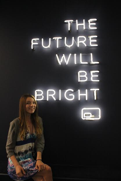 A sign in the lobby promises a bright future to those who look upon it.