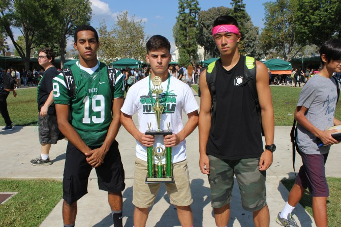 The Jungle leaders pose with the spirit trophy after the senior class won the spirit week challenges on Jungle Day.