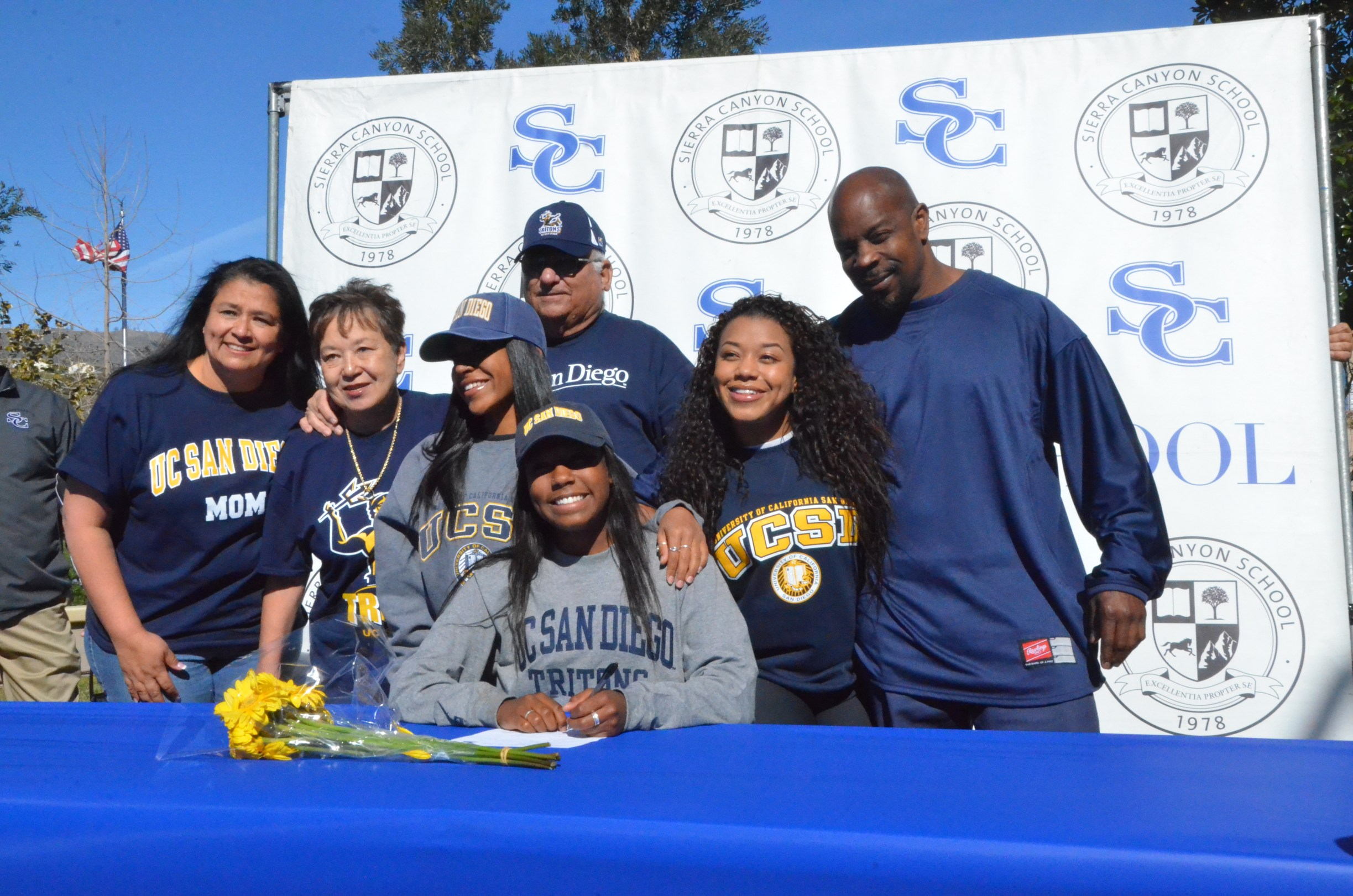 Bailey Hobson poses with her family for a signing day picture