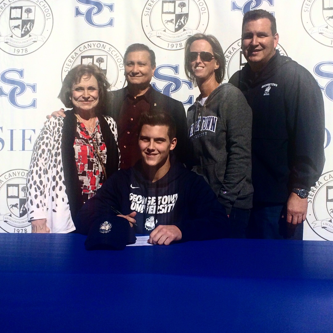 Hernandez (Center) with his grandparents (Left) and his parents (Right)