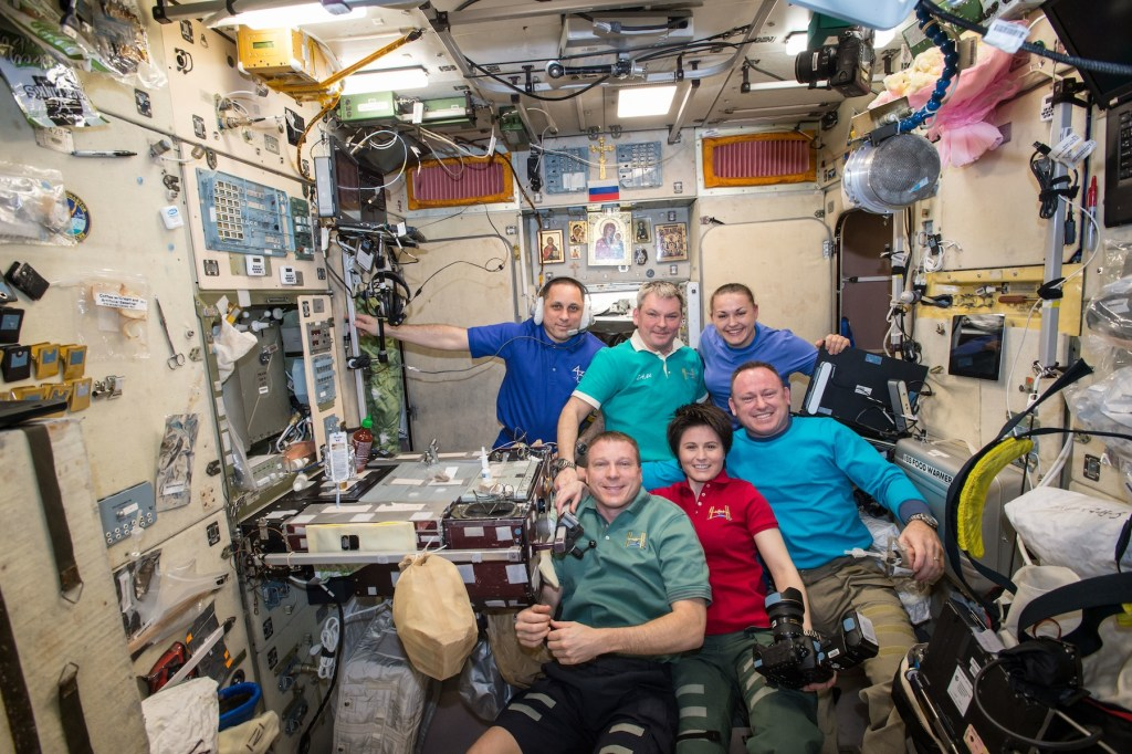 IMAX® film A Beautiful Planet – Onboard the International Space Station (ISS) – (Top L-R) Expedition 42/43 crew, Russian Federal Space Agency (RSA) cosmonauts Anton Shkaplerov, Alexander Samoukutyaev, Elena Serova, (Bottom L-R) NASA Commander Terry Virts, European Space Agency (ESA) astronaut Samantha Cristoforetti, NASA Barry (Butch) Wilmore. © 2016 IMAX Corporation Photo courtesy NASA