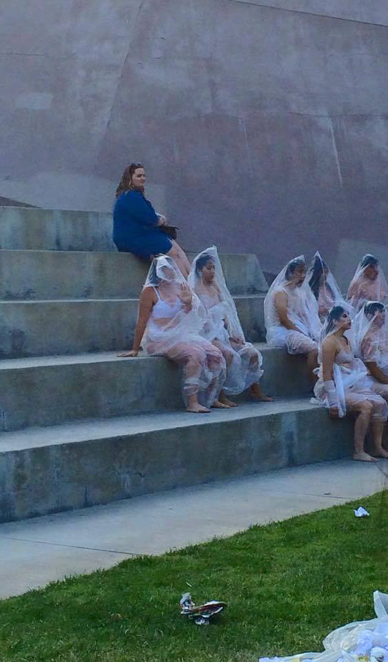 Choreographers on the steps of the UCR Arts building in trash bags, getting closer and closer to the audience in order to show the relationship between public and personal space.