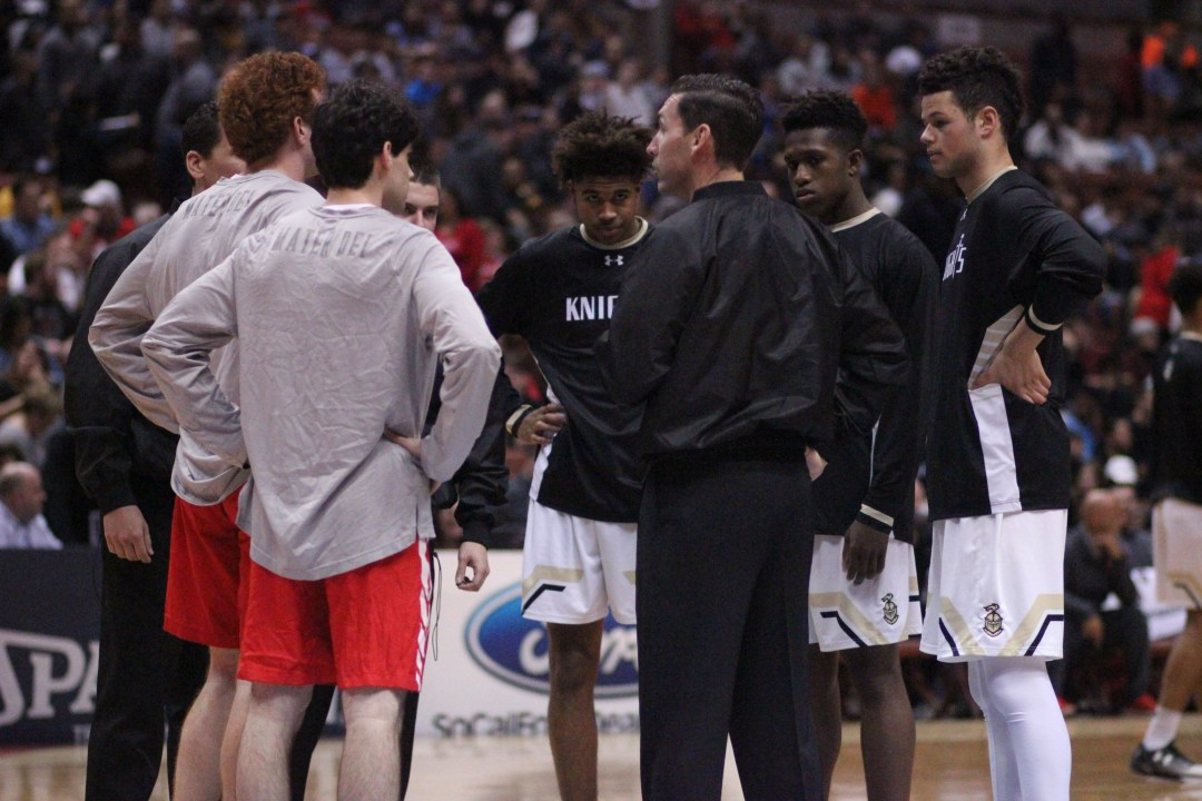 Spencer at center court for the captain's meeting, just before tip. Blake Atwell/ LA Times HS Insider