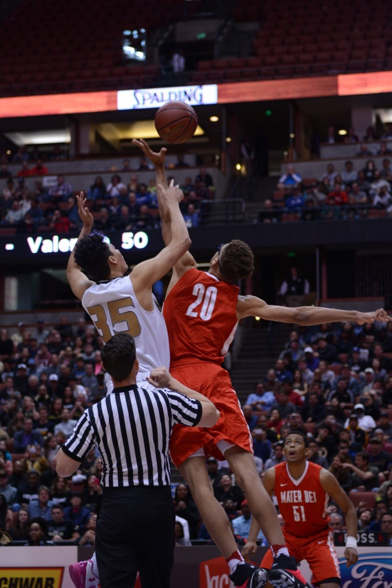 Mater Dei and Montgomery jump for the tip. Dylan Stewart/ LA Times HS Insider