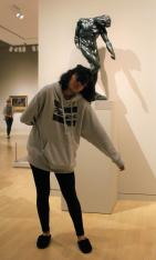Senior Nixia Bravo does her best to imitate a statue in the Dallas Museum of Art. The DPMHS Media team posed in front of statues like these, both for selfies and for fun memories in recreating a scene presented by the past. Photo by Rachel Bullock