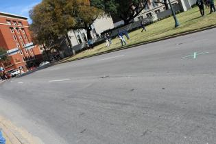 Students in the DPMHS Media team took a trip to Dealey Plaza to see where President John Fitzgerald Kennedy (JFK) was assassinated. The two green marks in the street signify where the points (estimated) were that he was shot. Photo by Rachel Bullock