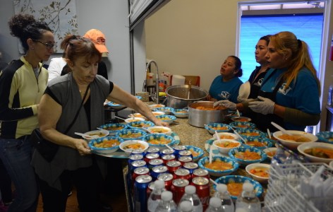 Serving food to migrants